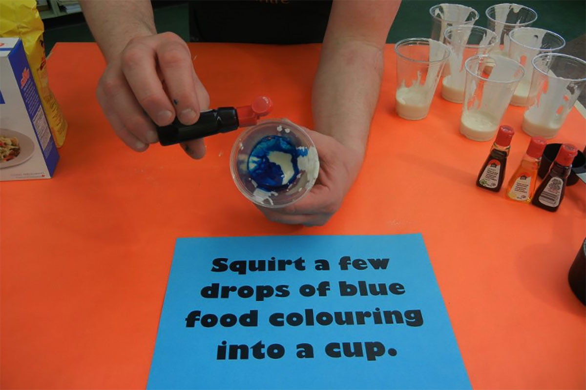 Separate into cups and add a few drops of food colouring